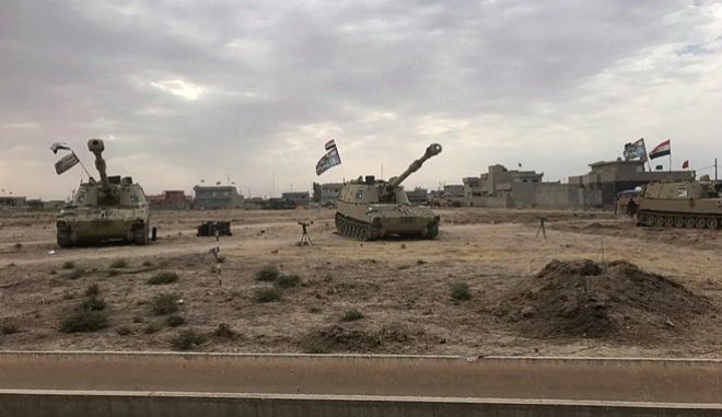 Iraqi tanks deploy in the village of Bashir, south of Kirkuk, Iraq, Friday, Oct. 13, 2017. Kurdish forces have withdrawn from the edges of a disputed region in northern Iraq, a commander said Friday, amid tensions with Iraq's central government over the administration of the oil-rich city of Kirkuk. (AP Photo/Emad Matti)