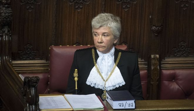 Sarah Clarke is introduced as the new Black Rod to the House of Lords in London Tuesday Feb. 20, 2018. It is the first time that a woman has been installed as Black Rod in the role's 650-year history. (Victoria Jones/Pool Via AP)