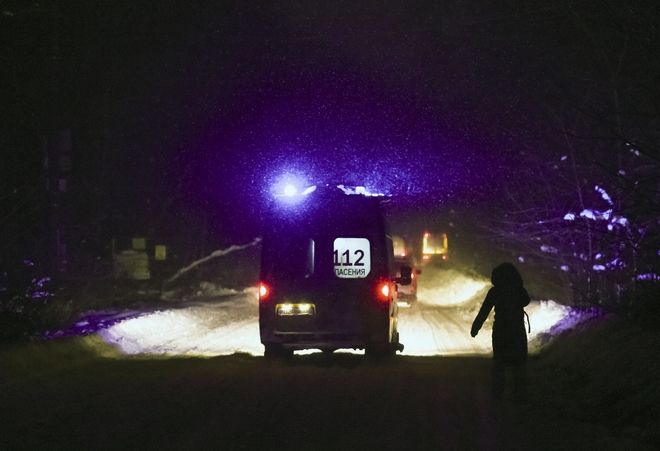 An ambulance van drives to the scene of a AN-148 plane crash in Stepanovskoye village, about 40 kilometers (25 miles) from the Domodedovo airport, Russia, Sunday, Feb. 11, 2018. Russia's Emergencies Ministry says a passenger plane has crashed near Moscow and fragments of it have been found. Russian officials say all passengers aboard the airliner that has crashed outside Moscow are believed to have been residents of the region that was the plane's destination. No survivors have been reported. (AP Photo/Nikolay Koreshkov)