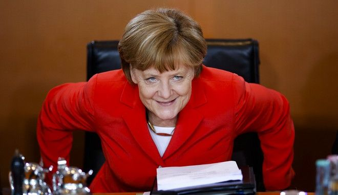 German Chancellor Angela Merkel takes her seat as she arrives for the weekly cabinet meeting at the chancellery in Berlin, Germany, Wednesday, May 27, 2015. (AP Photo/Markus Schreiber)