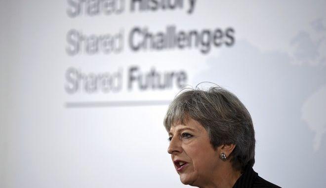 British Prime Minister Theresa May delivers her speech in Florence, Italy, Friday Sept. 22, 2017. May will try Friday to revive foundering Brexit talks  and unify her fractious government  by proposing a two-year transition after Britain's departure from the European Union in 2019 during which the U.K. would continue to pay into the bloc's coffers. (Jeff J Mitchell/Pool Photo via AP)