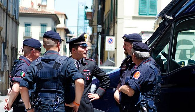 Five Italian police men have a quick chat on Satuday, June 14, 2014 in Florence, Italy. The police men were patroling around a soccer field for an upcoming game. (Breiana Whittaker 2014