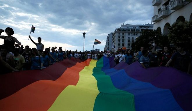"Gay activists waves a rainbow movement flag during a Pride parade, in Thessaloniki, Saturday, June 21, 2014. Thousands gay activists in Thessaloniki, Greece have organized the 3rd Thessaloniki Pride festival, a 2-day event that included a parade around the citys center. The organization of the event drew heavy criticism from conservative circles and there was a protest march against ""the sodomites"" on Friday. Thessaloniki, Greece on June 21, 2014."