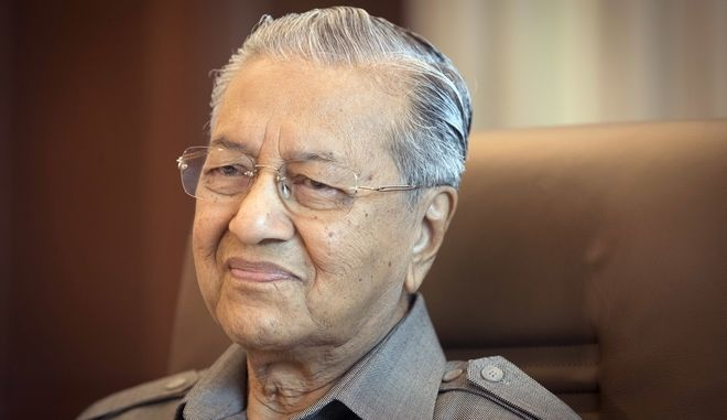 In this Sept. 15, 2017 photo, former Malaysian Prime Minister Mahathir Mohamad is interviewed in Kuala Lumpur, Malaysia.  Mahathir said in the Associated Press interview the opposition alliance campaigning to topple the country's corruption-tainted leader can win the next general elections and pull Malaysia back from a slide into kleptocracy.  (AP Photo/Vincent Thian)