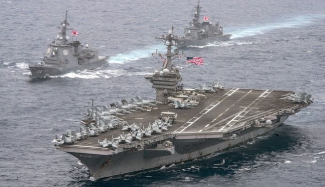 In this April 26, 2017 photo released by the U.S. Navy, the aircraft carrier USS Carl Vinson, foreground, transits the Philippine Sea with the Japan Maritime Self-Defense Force Atago-class guided-missile destroyer JS Ashigara, left front, and the JMSDF Murasame-class destroyer JS Samidare.  The aircraft supercarrier is headed toward  Korean Peninsula for an exercise with South Korea.  (Mass Communication Specialist 2nd Class Sean M. Castellano/U.S. Navy via AP)