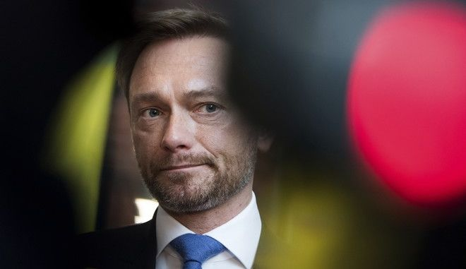 Leader of the  Free Democratic Party of Germany, FDP, Christian Lindner arrives for a board and faction meeting  of the FDP in Berlin, Monday, Nov. 20, 2017. German Chancellor Angela Merkel pledged early Monday to maintain stability after the Free Democratic Party pulled out of talks on forming a new government with her conservative bloc and the left-leaning Greens, raising the possibility of new elections. (Bernd von Jutrczenka/dpa via AP)