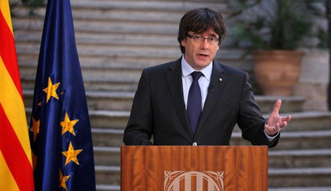 Catalan President Carles Puigdemont speaks during a statement at the Palau Generalitat in Barcelona, Spain, on Saturday, Oct. 28, 2017. Catalonia's separatist leader has called on Catalans to peacefully oppose Spain's takeover, in a staged appearance that seemed to convey that he refuses to accept his firing, which was ordered by central authorities (Presidency Press Service, Pool Photo via AP)