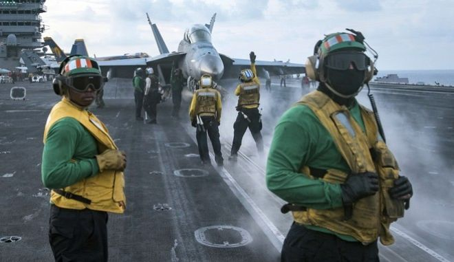 In this photo provided by the U.S. Navy, sailors conduct flight operations on the aircraft carrier USS Carl Vinson (CVN 70) flight deck in April 8, 2017.  The Trump administration deployed an aircraft carrier to the region this week in a show of force that also could expose American weakness. If the North proceeds with a ballistic missile or nuclear test and the U.S. does nothing in response, Americas deterrence will appear diminished. The USS Carl Vinson is steaming to waters off the Korean Peninsula as anticipation mounts that Kim Jong Un will stage another weapons test around the anniversary of the nations founder on Saturday.(Mass Communication Specialist 3rd Class Matt Brown/U.S. Navy via AP)