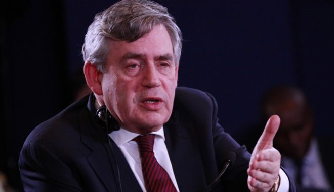 Former British Prime Minister Gordon Brown, speaks during the World economic forum on Africa in Abuja, Nigeria, Friday, May 9, 2014. (AP Photo/Sunday Alamba)