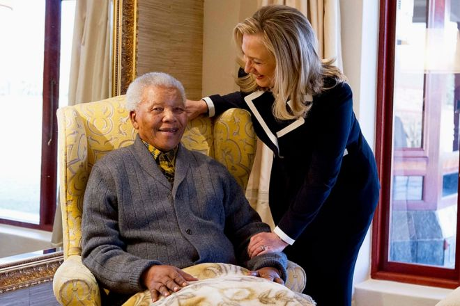 U.S. Secretary of State Hillary Clinton meets with Nelson Mandela, 94, former president of South Africa, at his home in Qunu, South Africa, August 6, 2012. Clinton praised the