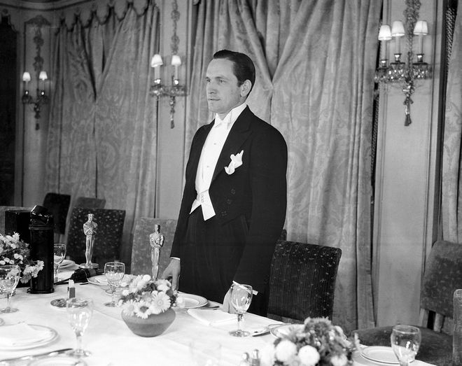 """Fredric March acknowledges the applause during dinner of the 1931-32 Motion Picture Academy Awards at the Ambassador Hotel in Hollywood, Ca., Nov. 18, 1932.  March won for best actor in """"Dr. Jekyll and Mr. Hyde.""""  (AP Photo)"""