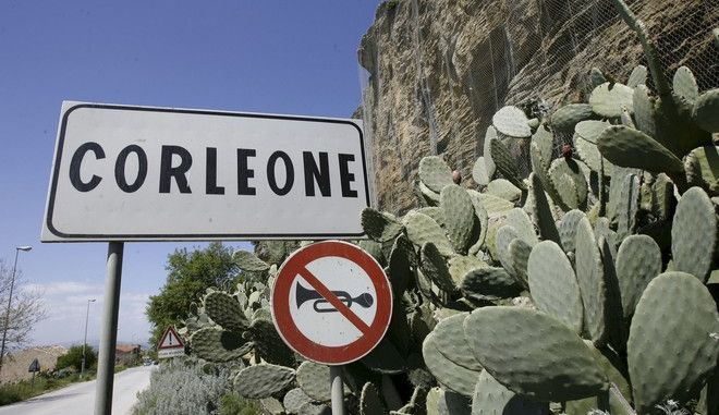 FILE -- In this file photo taken on April 12, 2006, a road sign announces the town of Corleone, Italy. Premier Matteo Renzis Cabinet dissolved Corleones municipal government because  of Mafia infiltrations and put its City Hall under temporary control of the interior ministry. Corleone is the Sicilian town inspiring the fictional crime clans name in The Godfather novel and movie. (AP Photo/Luca Bruno)