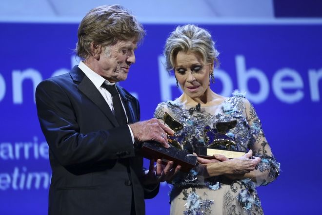 Actors Robert Redford, left, and Jane Fonda accept their Lifetime Achievement Awards during the 74th edition of the Venice Film Festival in Venice, Italy, Friday, Sept. 1, 2017. (Photo by Joel Ryan/Invision/AP)