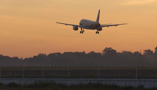 A plane prepares to land at the Yangon international airport, Thursday, Jan. 11, 2018, in Yangon, Myanmar. (AP Photo/Thein Zaw)
