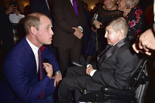 Britain's Prince William meets Moin Younis as he attends the Pride of Britain Awards 2017, at Grosvenor House, Park Lane, London, Monday, Oct. 30, 2017. (Andy Stenning/Pool Photo via AP)