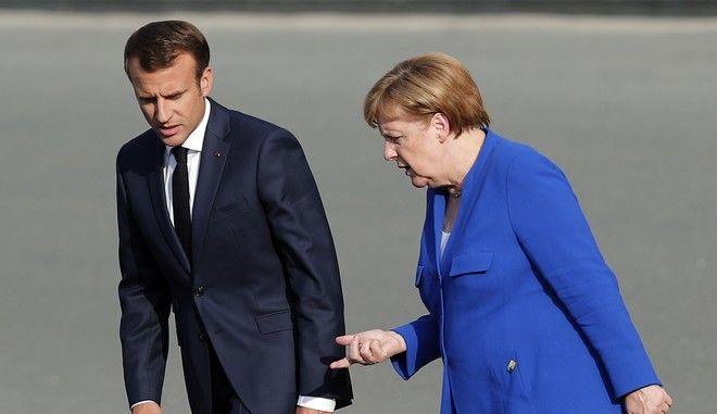 Ο Γάλλος πρόεδρος Εμανουέλ Μακρόν και η Γερμανίδα καγκελάριος Άνγκελα Μέρκελ