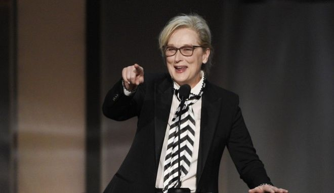 Actress Meryl Streep gestures to actress Diane Keaton in the audience during the 45th AFI Life Achievement Award Tribute to Keaton at the Dolby Theatre on Thursday, June 8, 2017, in Los Angeles. (Photo by Chris Pizzello/Invision/AP)