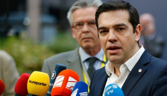 epa05073042 Greek Prime Minister Alexis Tsipras arrives at the EU Summit in Brussels, Belgium, 17 December 2015. EU leaders meet in Brussels for its year-end summit with highly controversial British demands for reforms expected to be discussed. Sanctions against Russia, Europe's migration crisis, the fight against terrorism and the crisis in Syria are also expected to round out the agenda of the two-days summit on 17 and 18 December.  EPA/LAURENT DUBRULE