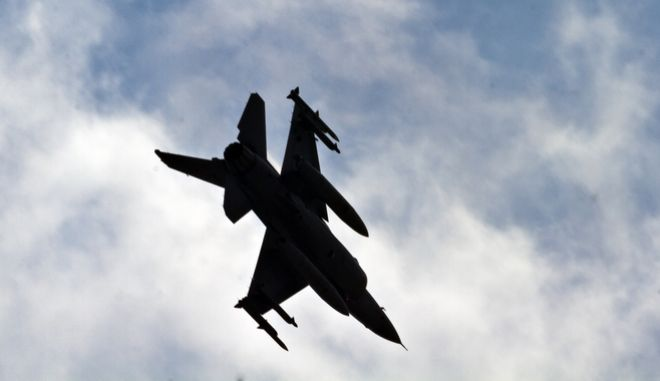 A Turkish Air Force F16 fighter jet makes a landing approach at the Incirlik Air Base, Turkey, Friday, Aug. 30, 2013. U.N. Secretary-General Ban Ki-moon said the Inspection team in Syria is expected to complete its work Friday and report to him Saturday. (AP Photo/Vadim Ghirda)