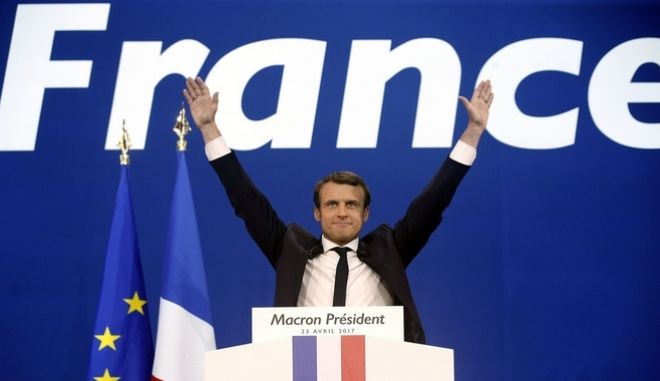 FILE - In this Sunday April 23, 2017 file photo, French centrist presidential candidate Emmanuel Macron waves before addressing his supporters at his election day headquarters in Paris. They could hardly be more different: Pro-European centrist Emmanuel Macron is facing anti-immigration, anti-EU Marine Le Pen in Frances presidential runoff May 7. (AP Photo/Thibault Camus, file)