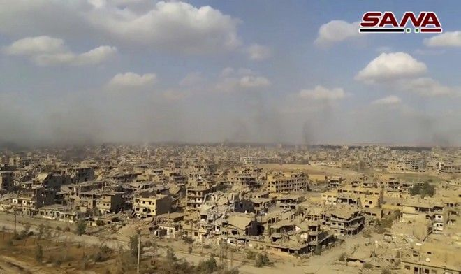 This frame grab from a video released on Nov. 2, 2017 by the Syrian official news agency SANA shows the destroyed in the Deir el-Zour city during a battle against Islamic State militants, Syria. The Syrian army announced on Friday it liberated the long-contested eastern city of Deir el-Zour from the Islamic State group. (SANA via AP)