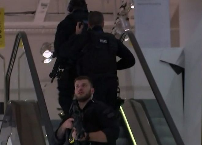 In this grab taken from video, armed police patrol a department store, near to Oxford Street, in London, Friday, Nov. 24, 2017.  British police said Friday they were responding to reports of an incident at Oxford Circus subway station, one of London's busiest. (AP)