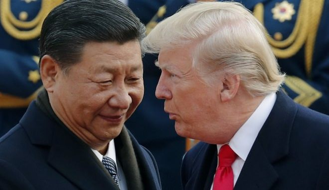 FILE - In this Nov. 9, 2017, file photo, U.S. President Donald Trump, right, chats with Chinese President Xi Jinping during a welcome ceremony at the Great Hall of the People in Beijing. Seeking Chinas help on isolating North Korea through economic sanctions, Trump backed off a threat to label China a currency manipulator. He was off-and-on conciliatory on trade during an extended visit to Asia in November, and China announced it would lift restrictions on foreign investment in its banks and other financial institutions.  (AP Photo/Andy Wong, File)