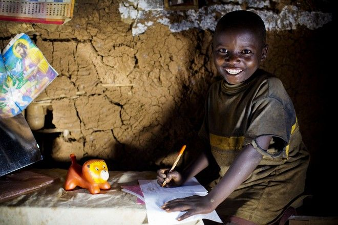 Ca Depend does his homework at his Grandparents home, where he lives.  Idjwi Sud, DR Congo Thursday, Sept. 25, 2014