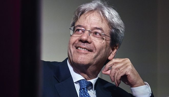 Italian Prime Minister Paolo Gentiloni smile during a conference at Casa Italiana Zerilli-Marimo at New York University, Tuesday, Sept. 19, 2017, in New York. (AP Photo/Andres Kudacki)