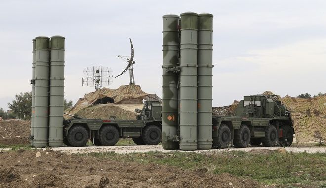 FILE - In this file photo taken Dec. 16, 2015 and provided by the Russian Defense Ministry Press Service, Russian S-400 long-range air defense missile systems are deployed at Hemeimeem air base in Syria. Russia's defense ministry said Tuesday, March 15, 2016, that the first group of warplanes stationed at the Russian air base in Syria has left for home following a pullout order from President Vladimir Putin. (Vadim Savitsky/Russian Defense Ministry Press Service via AP, File)