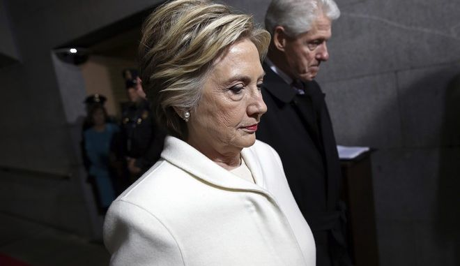 Former Presidential Bill Clinton and wife Hillary Clinton arrive on the West Front of the Capitol in Washington, Friday, Jan. 20, 2017, for the presidential inauguration of Donald Trump. (Win McNamee via AP, Pool)