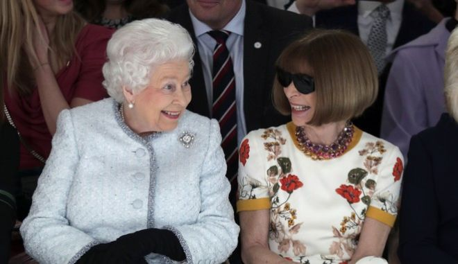 Britain's Queen Elizabeth sits next to fashion editor Anna Wintour as they view Richard Quinn's runway show before presenting him with the inaugural Queen Elizabeth II Award for British Design, as she visits London Fashion Week's BFC Show Space in central London, Tuesday, Feb. 20, 2018. (Yui Mok/Pool photo via AP)