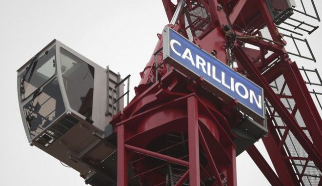 A crane bearing the name of Carillion, at a construction site in central London, Monday Jan. 15, 2018, as the construction and services giant Carillion has gone into liquidation.  In a statement released Monday, Carillion says it had no choice but to go into liquidation after weekend talks with creditors and government officials failed. (Yui Mok/PA via AP)