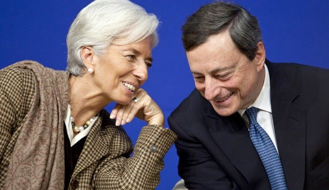 "Christine Lagarde, managing director of the International Monetary Fund (IMF), left, speaks with Mario Draghi, president of the European Central Bank (ECB), during a financial conference at the Ministry of Economy, Finance and Industry in Paris, France, on Friday, Nov. 30, 2012. The European Central Bank will do ""whatever is necessary to save euro"" and is ready to intervene when needed, Draghi said, while saying ""there will always be conditions"" to intervention. Photographer: Balint Porneczi/Bloomberg via Getty Images"