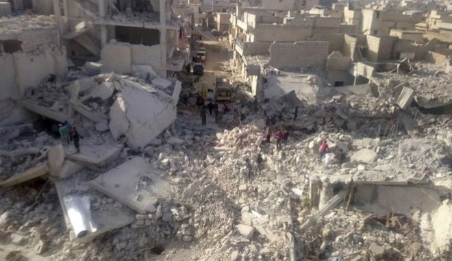 This photo released Nov. 14, 2017 by the Syrian anti-government activist group Local Council of Atareb City, which has been authenticated based on its contents and other AP reporting, shows a destroyed market that was struck by Russian warplanes in the town of Atareb in Idlib province, Syria. The U.N.s Commission of Inquiry on Syria said Tuesday, March 6, 2018, that a Russian plane was apparently behind the deadly airstrike in November in Syrias Idlib province that killed 84 people at a marketplace, an attack which could amount to a war crime. (Local Council of Atareb City via AP)