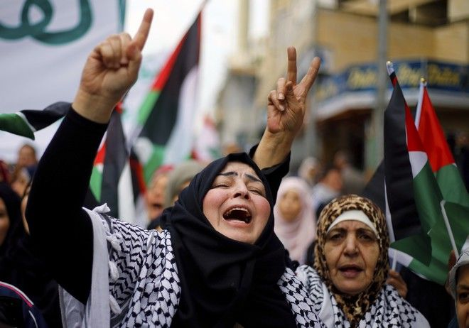 Protesters chant slogans after Friday prayers during a march in the streets of Beirut, Lebanon, Friday, Dec. 8, 2017, against U S. President Donald Trump's decisions to recognize Jerusalem at the capital of Israel in Beirut. (AP Photo/Bilal Hussein)