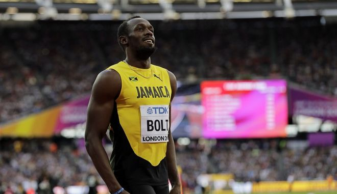Jamaica's Usain Bolt smiles after finishing his Men's 100 meters semifinal during the World Athletics Championships in London Saturday, Aug. 5, 2017. (AP Photo/Tim Ireland)