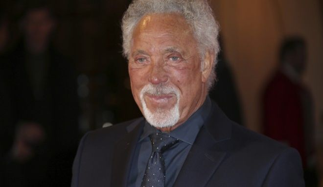 Sir Tom Jones poses for photographers upon arrival at the ITV Gala event in London, Thursday, Nov. 24, 2016. (Photo by Joel Ryan/Invision/AP)