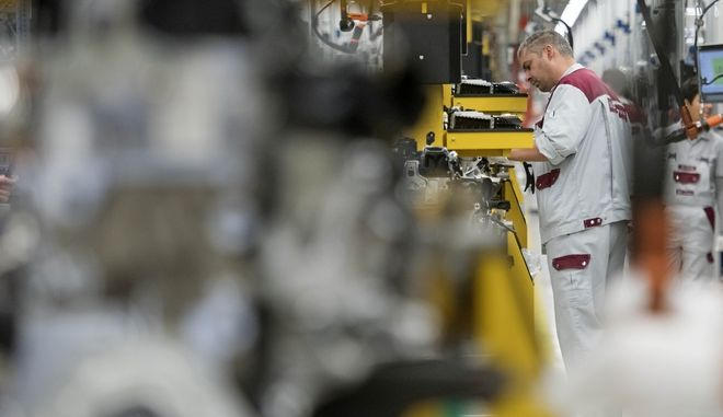 A worker completes the new four-cylinder diesel engine OM 654 during the official start of production in the MDC Power GmbH, a company of the German Daimler AG, in Koelleda, central Germany, Friday, Oct. 23, 2015. MDC, a wholly owned subsidiary of Daimler AG, manufactures engines for various Mercedes car and van models and other cars. (AP Photo/Jens Meyer)