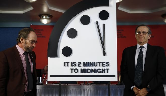 Robert Rosner, chairman of the Bulletin of the Atomic Scientists, right, and Bulletin of the Atomic Scientists member Lawrence Krauss, left, stand next to the Doomsday Clock after unveiling it during a news conference at the National Press Club in Washington, Thursday, Jan. 25, 2018., announcing that the Bulletin of the Atomic Scientists has moved the minute hand of the Doomsday Clock to two minutes to midnight. ( AP Photo/Carolyn Kaster)