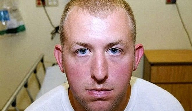 """Rex Features Ltd. do not claim any Copyright or License of the attached image Mandatory Credit: Photo by REX (4270957g) Photo showing injuries suffered by police officer Darren Wilson Michael Brown shooting by a police officer in Ferguson, Missouri, America - 25 Nov 2014 Police Officer Darren Wilson who shot dead Michael Brown, 18, aka """"Big Mike Jr Brown,"""" in Ferguson, Missouri, On August 9. He was shot at least six times, including twice in the head and a grand jury has decided not to indict the officer over the shooting. Missouri has descended into lawlessness as a result of the decision on Monday night with looting, fires and chaos. Businesses have been set on fire and there has been gunfire, cars and windows vandalised and police have retaliated with tear gas and pepper sprary to disperse the crowds. Officer Darren Wilson was suspended with pay since after the shooting and Mr Brown's family sought """"justice"""" and called for his arrest and prosecution. Officer Brown is pictured here in a photo presented in evidence to the grand jury showing the injuries he received including redness/bruising to the back of the head and right hand side of his face that he said he suffered before the shooting when Michael Brown punched him in the face."""
