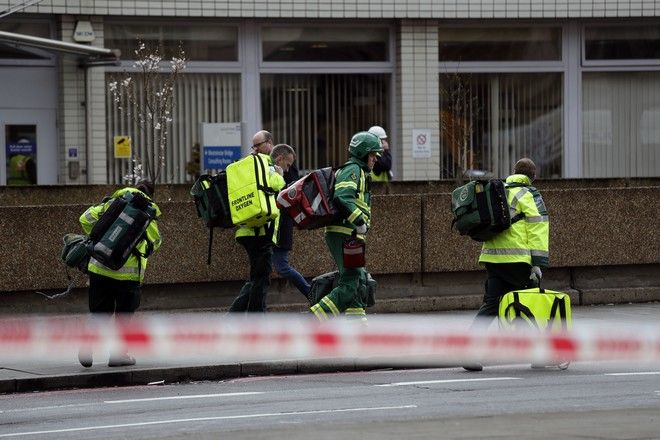Emergency service workers arrive on the scene  close to the Houses of Parliament in London, Wednesday, March 22, 2017. The leader of Britain's House of Commons says a man has been shot by police at Parliament. David Liddington also said there were