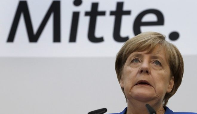 "German Chancellor and chairwoman of the German Christian Democratic Party (CDU), Angela Merkel, attends a press conference at the party's headquarter in Berlin, Germany, Monday, Oct. 16, 2017, one day after the elections in the German state of Lower Saxony. Letters read ""Center"". (AP Photo/Michael Sohn)"