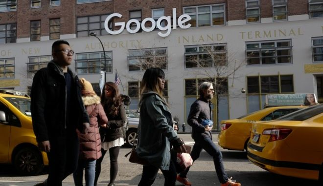 People walk by Google offices, Monday, Dec. 4, 2017, in New York. (AP Photo/Mark Lennihan)