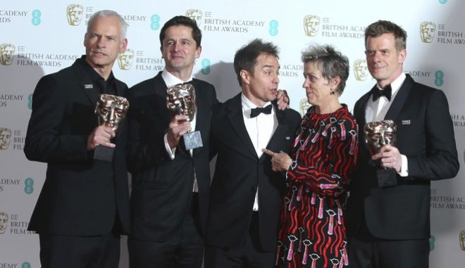 Director Martin McDonagh, from left, producer Peter Czernin, actors Sam Rockwell, Frances McDormand and producer Graham Broadbent pose for photographers backstage with their Best Film awards for 'Three Billboards Outside Ebbing, Missouri' at the BAFTA 2018 Awards in London, Sunday, Feb. 18, 2018. (Photo by Joel C Ryan/Invision/AP)