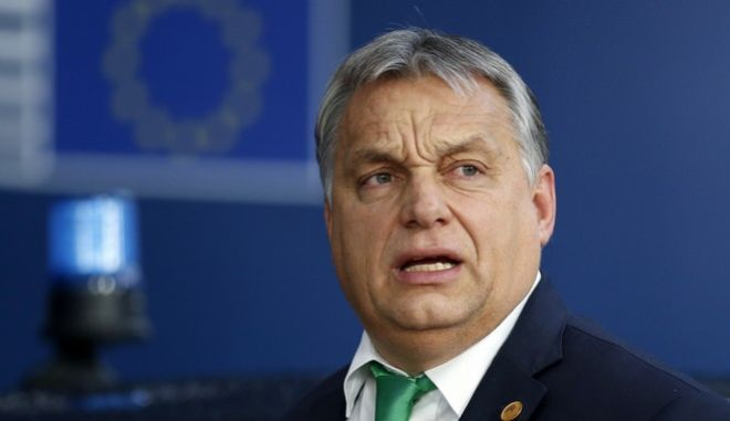 Hungarian Prime Minister Viktor Orban arrives for an EU summit at the Europa building in Brussels on Thursday, Dec. 14, 2017. European Union leaders are gathering in Brussels and are set to move Brexit talks into a new phase as pressure mounts on Prime Minister Theresa May over her plans to take Britain out of the 28-nation bloc. (Francois Lenoir, Pool Photo via AP)