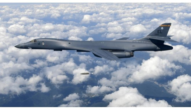 "FILE - In this Sept. 18, 2017, file photo provided by South Korea Defense Ministry, a U.S. Air Force B-1B bomber drops a bomb as it flies over the Korean Peninsula during a joint drills, South Korea. A South Korean lawmaker said Tuesday, Oct. 10, 2017, that North Korean hackers may have stolen highly classified military documents that include U.S.-South Korean wartime ""decapitation strike"" plans against the North, according to South Korean media reports. (South Korea Defense Ministry via AP, File)"
