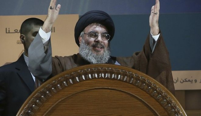 FILE - In this Aug. 2, 2013, file photo, Hezbollah leader Sheikh Hassan Nasrallah gestures during a rally to mark Jerusalem day or Al-Quds day, in a southern suburb of Beirut, Lebanon. The leader of Lebanon's Hezbollah on Monday, Nov. 20, 2017, categorically denied accusations that his group is sending weapons to Yemen or that it was responsible for a ballistic missile fired by Shiite rebels in Yemen that was intercepted near the Saudi capital, Riyadh. (AP Photo/Hussein Malla, File)