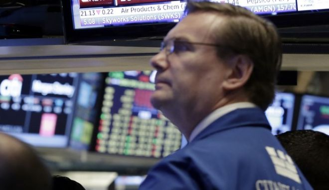 A headline on a television screen describes trading activity on the floor of the New York Stock Exchange, Wednesday, May 17, 2017. Financial companies led U.S. stocks sharply lower in early trading as investors fretted over the potential fallout roiling the Trump administration. (AP Photo/Richard Drew)