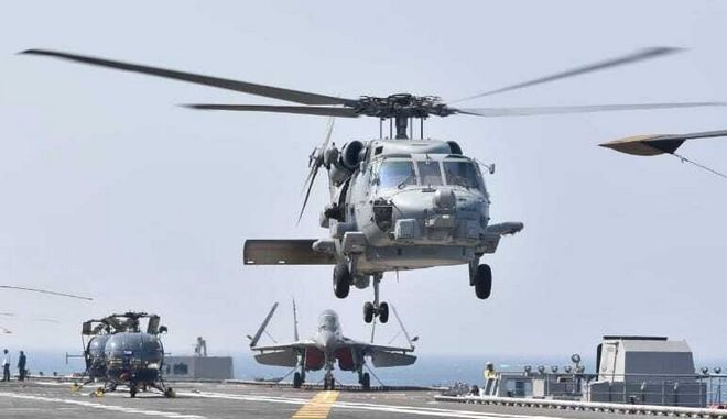 Choppers land on an aircraft carrier during the second phase of Malabar naval exercise, a joint exercise comprising of India, US, Japan and Australia, in the Northern Arabian Sea on Tuesday, Nov. 17, 2020. The navies of India, the United States, Australia and Japan held exercises Tuesday in the Northern Arabian Sea in the second phase of a naval drill seen as part of a regional initiative to counter Chinas growing assertiveness in the Indo-Pacific. (Indian Navy via AP)
